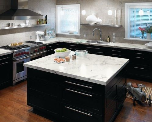 Laminate Countertop, Carrera marble, more in my price range and they look great