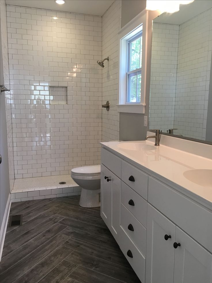 This fantastic master bath has adjoining walk in closet and huge walk in shower….