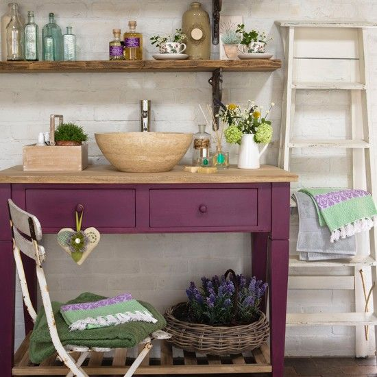 Add a vibrant touch to your country bathroom space with a brightly coloured washstand - team with pretty accessories and towels