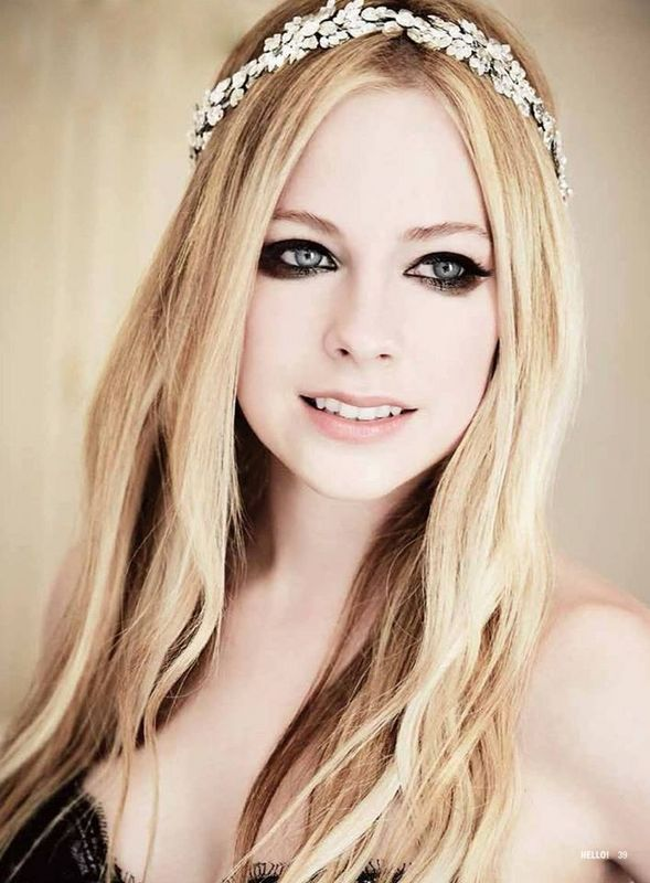 """Avril Lavigne is a talented performer but I only like a few of her songs. """"Skater Boy"""", """"When Your Gone"""", """"Complicated"""", but most of all, her newest song """"Here's To Never Growing Up""""."""