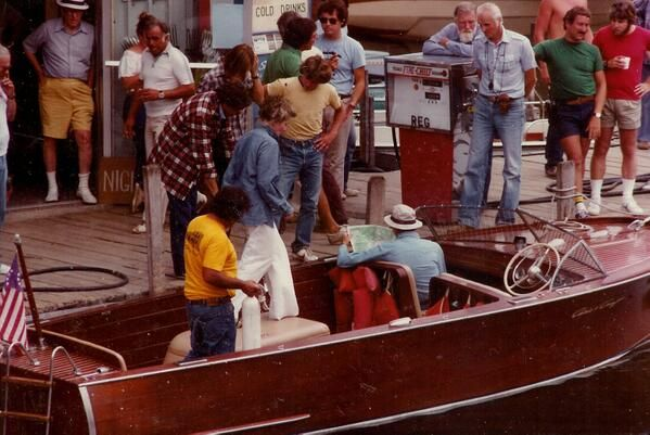 Crew readies Hepburn and Fonda for a boat scene during filming of ON GOLDEN POND, 1980.