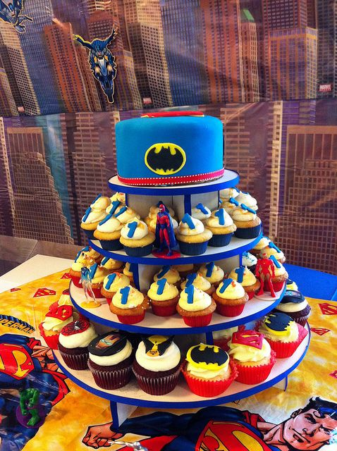 Super hero cupcake tower with mini cake on top