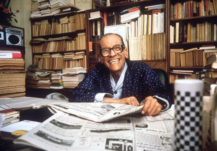 Naguib Mahfouz smiles in his Cairo home, 19 October 1988, a few days after the…