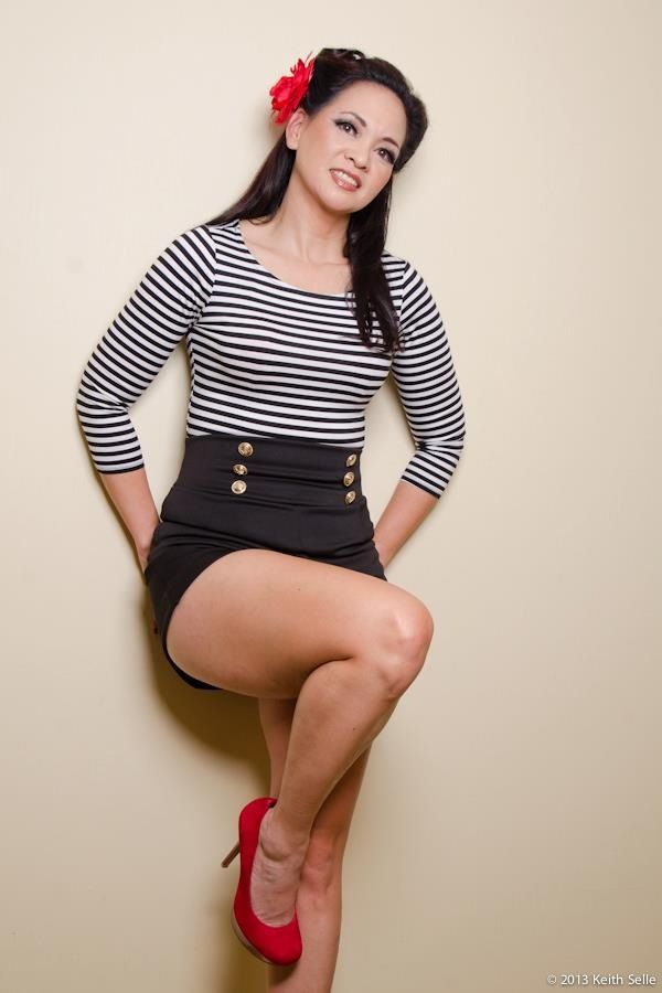 Pin up girl outfit...high waisted shorts and blue and white stripped shirt, red heels. Photographed by Keith Selle