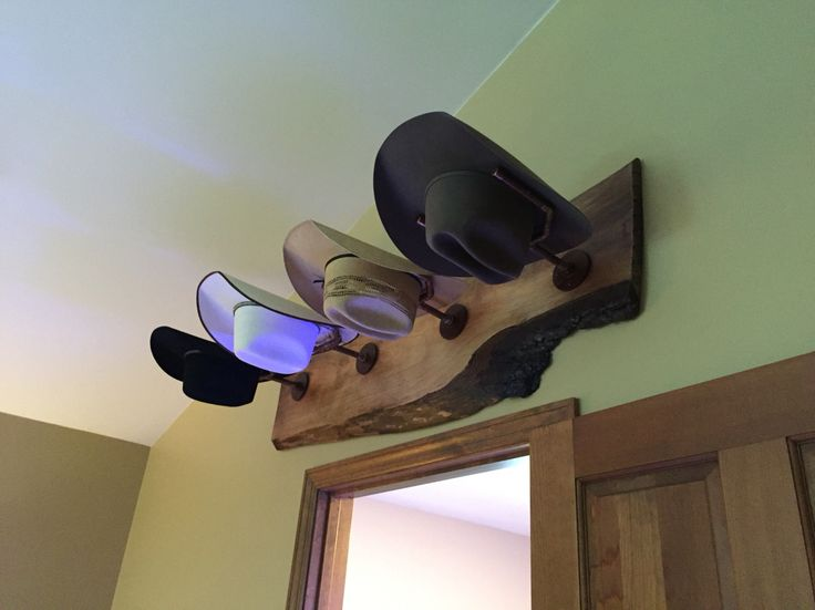 Cowboy hat rack. Rustic pipe steampunk live edge wood.