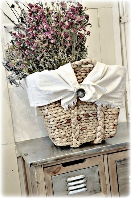 love the faded colors of the basket and flowers:)