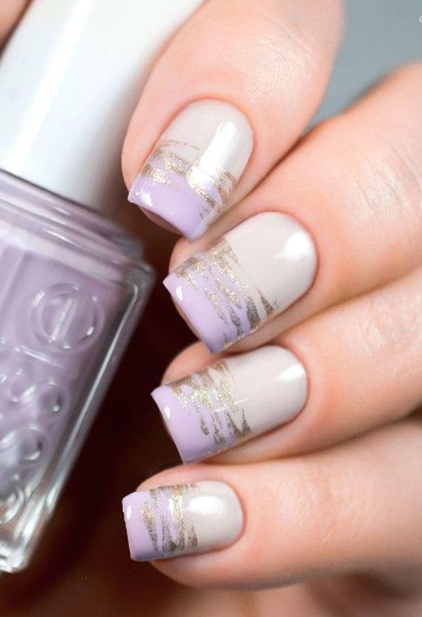 Light Purple nail art design. Simple yet beautiful Purple nail art design with hints of silver glitter polish aligned on top.