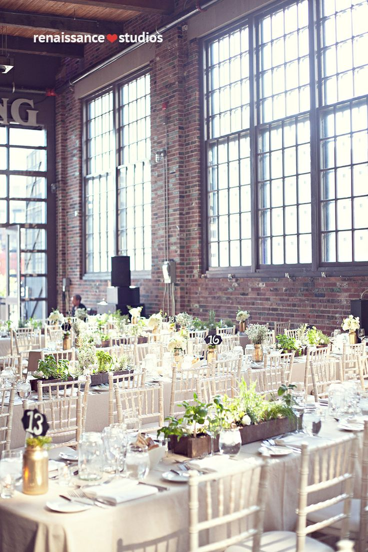 Wedding centrepiece wood boxes with herbs and mason jars with flowers on long burlap tables