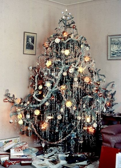 Balsam Christmas tree with light reflectors, lead icicles and a Noma brand lighted star on top.