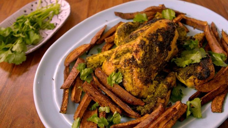 Turmeric roast chicken with roasted sweet potato chips with pomegranate molasses