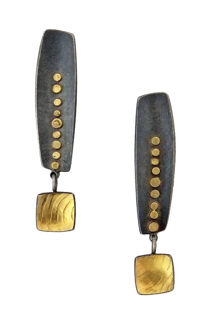 Long Inca Earrings by Sydney Lynch. Softened geometric forms create a bold, balanced design in these earrings with deeply oxidized sterling silver providing dramatic counterpoint to gleaming 18k and 22k gold. Sterling silver earwires.