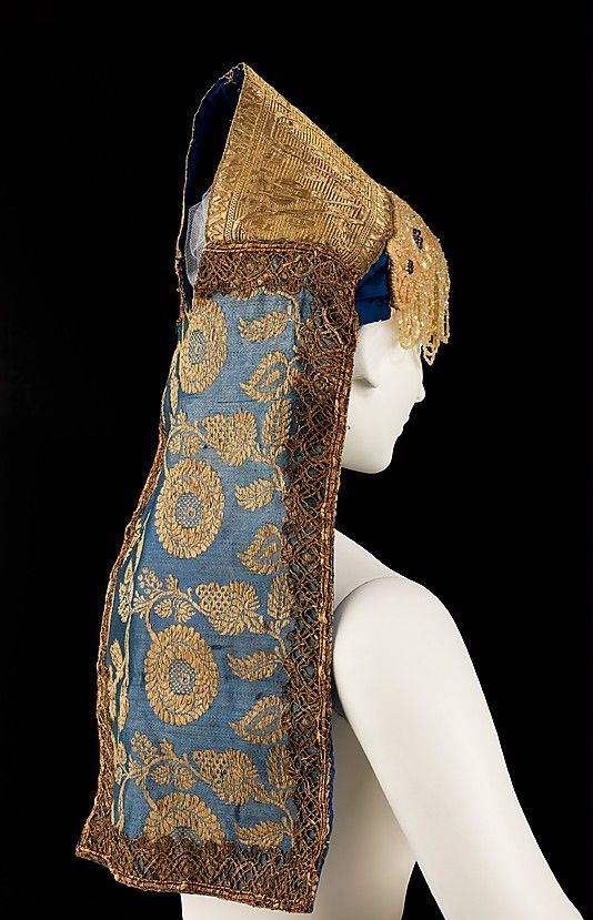 Headdress (back view) | Russia, first quarter 19th century | Materials: silk, metal, shell, glass | This headdress follows the coronet shape common to maiden's headwear in Russia while incorporating the forehead veil effect of the 'venchik' | Unlike in most headdresses where the venchik is a separate piece, the characteristic beaded veil is attached directly to the headdress | The Metropolitan Museum of Art, New York