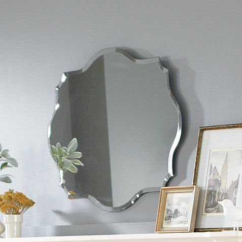 Showcasing a beveled edge and Baroque-inspired silhouette, this classic wall mirror makes a stylish accent for your master suite or powder room.