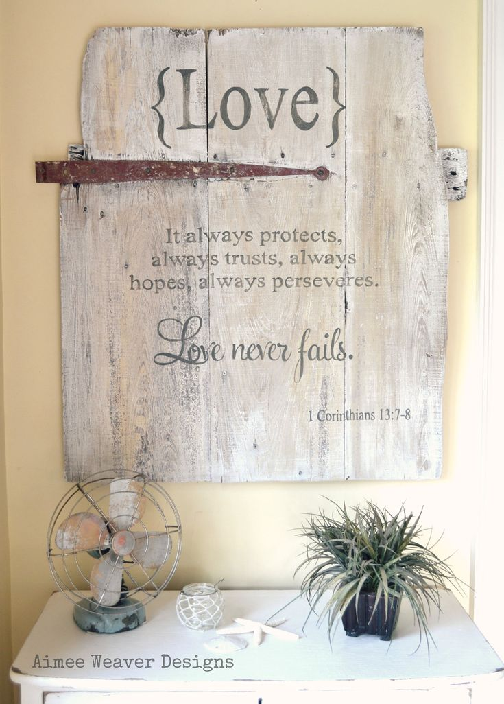Handpainted wood barn door sign with love verse. $150.00, via Etsy.
