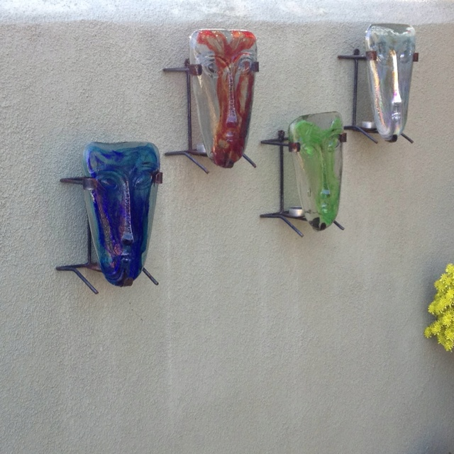 Glass candle masks from Mexico. On our front patio.