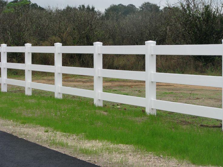 Beautiful, white 4 rail ranch fence by Mossy Oak Fence Company