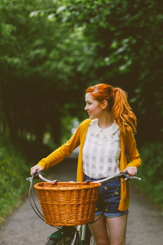 """This is a really beautiful redheaded girl. I am very partial to that color. This is how girls looked when I was a teen. This goes for the big and heavy 26-28 inch bike with the wicker basket. Love this. It it is filled with many memories for me. """"The Clothes Horse"""""""