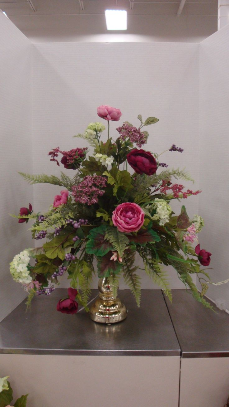A mixed arrangement of ranunculus hydrangeas and