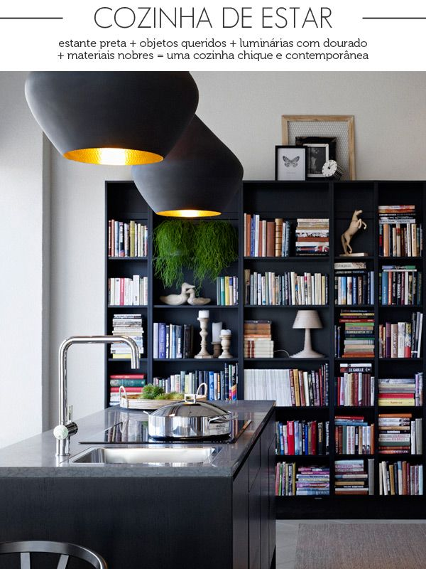 black bookcase in the kitchen and the lighting. loved to have my references so close to the kitchen.