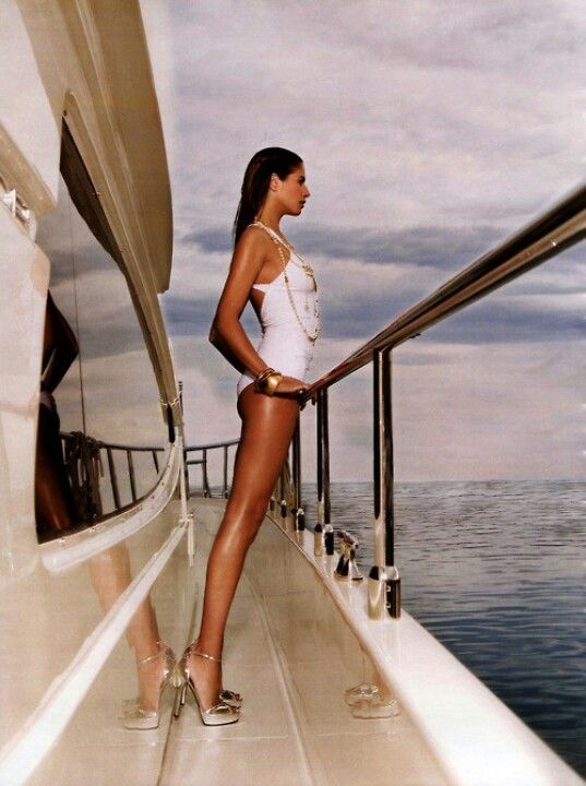 #White One Piece swimsuit perfectly accessorized from the jewelry to the shoes to the Yacht!