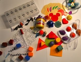 Limited Edition Early Learning Kit $25 Activities:  Pill Box Open and Close with tiny animals  Bath mat and dropper  Paint Chip matching game with tiny objects  Measuring game with cards and linking cubes  Fruit tonging in paint tray  Sensory bowl with 10 tiny objects (just add ice!)  3D Shape Match with plastic shape blocks  Play-Doh hiding game with 10 tiny objects