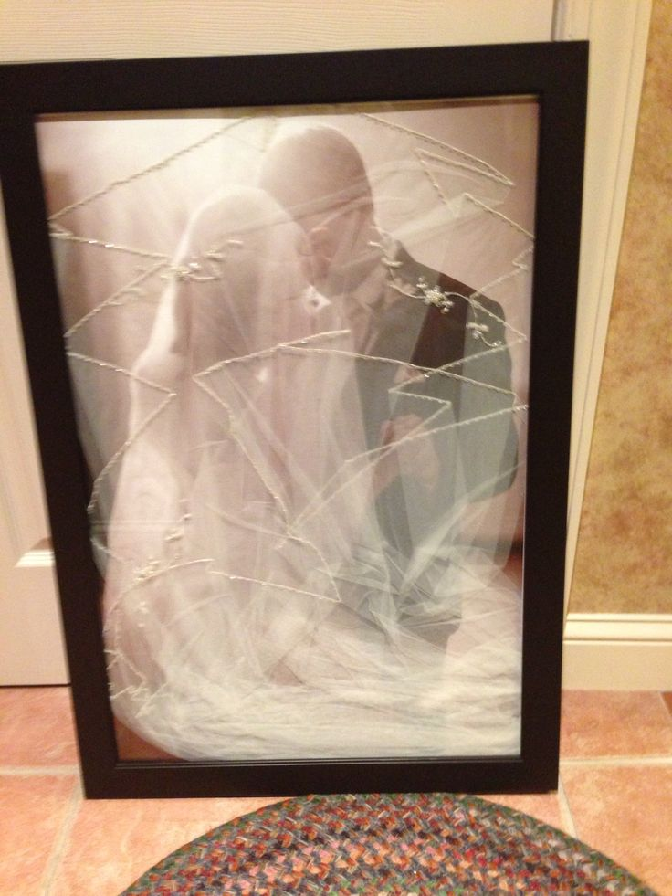 Wedding veil over your wedding picture...a great way to preserve it and show it off for years to come!!