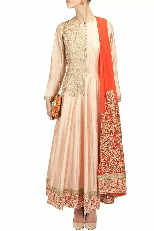 Heavily embroidered with zardozi on the orange dupatta is genius as it compliments the champagne coloured anarkali. Recreated at Shefali's Studio shefalis_studio@hotmail.com