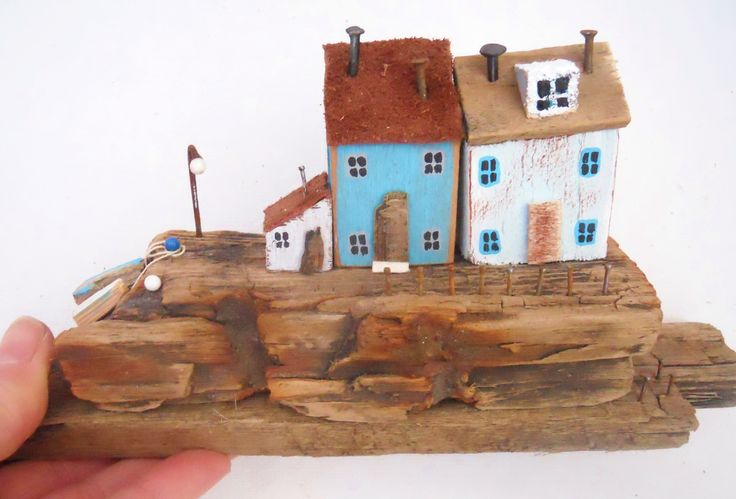 A little smokehouse on the side of a fishermen's cottage on a quaint harbour