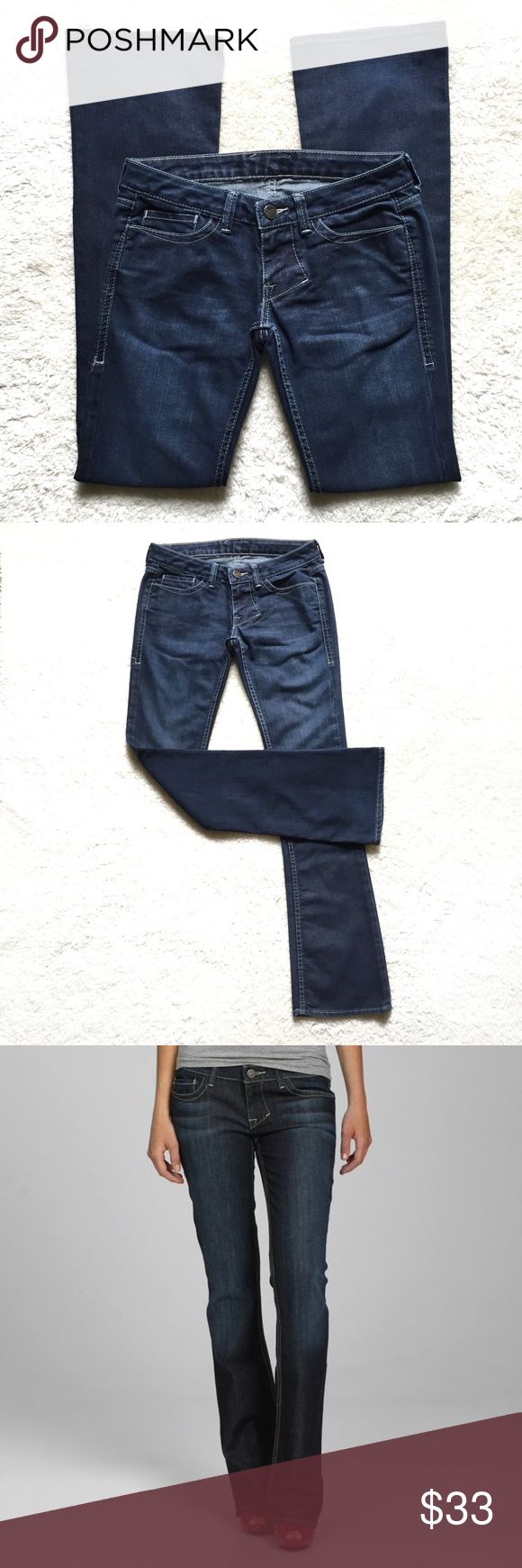 """William Rast Stella Bootcut Jeans Soft, dark blue classic bootcut denim with cream contrast stitching and light stretch. Whiskering along front pockets. Five-pocket styling with zip fly and belt loops. 75% cotton; 25% polyester. Size 26. Waist: 14.5"""" flat across.  Rise: 6.5"""".  Inseam: 33"""".  Leg opening: 8"""" across. The inside tags have peeled off and these have some light wear. Very Good Conition. William Rast Jeans Boot Cut"""