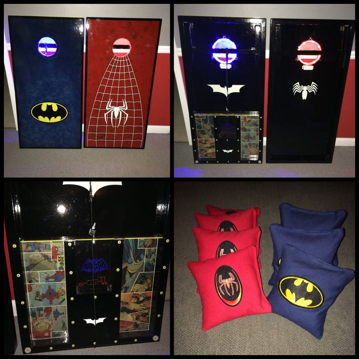 Batman/Spider-man cornhole boards with built in bag storage, lights and distance measuring tape.