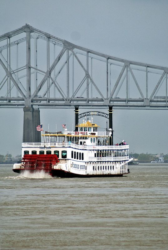 MIssissippi Bridge and the steamboat Creole Queen, Mississippi River near New Orleans, Louisiana