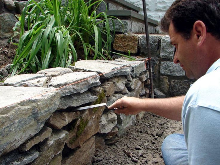 DIYNetwork.com experts create a stone garden feature in the style of traditional country farm walls.                                                                                                                                                                                 More