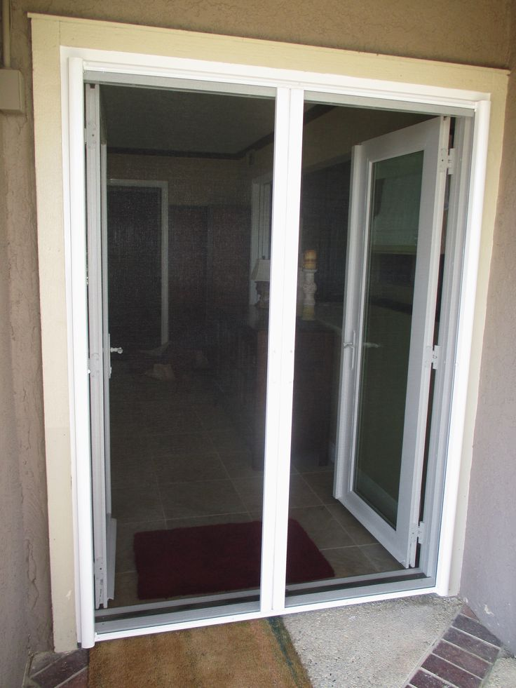 205 best french door stowaway retractable screen doors for Retractable double screen door