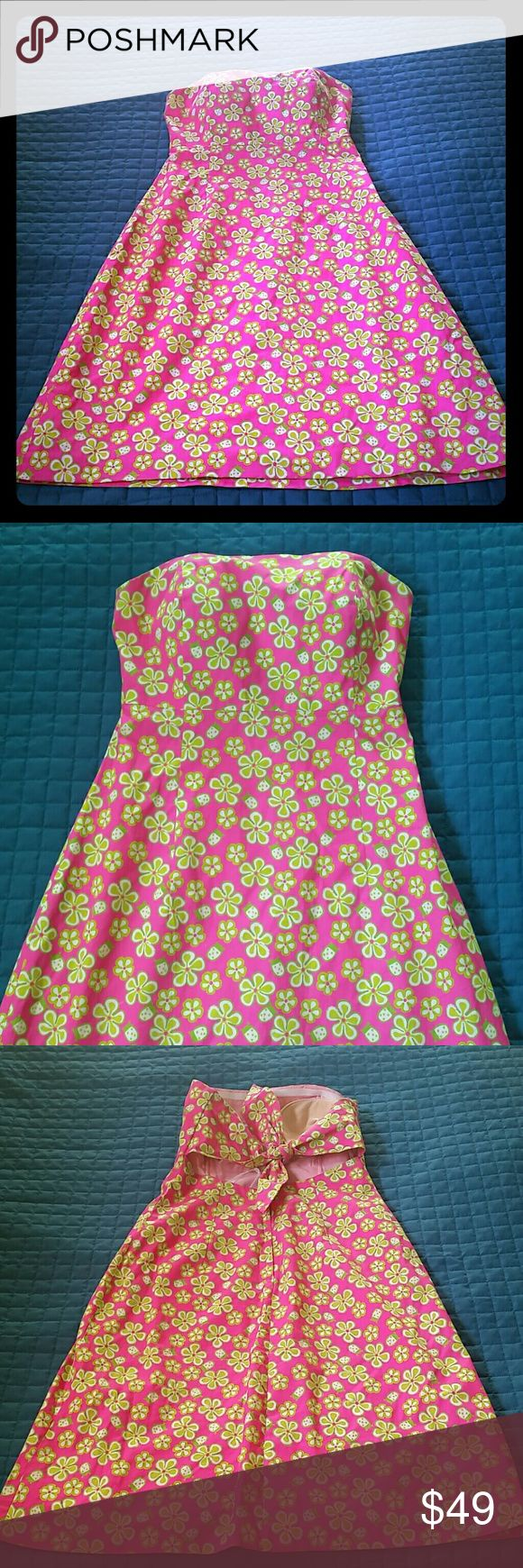 4 Lilly Pulitzer Strapless Summer Dress Like new condition.  Size 4 goes to the knees.  Neon pink super fun and catchy Lilly Pulitzer Dresses Midi