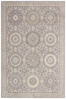 Rich in old world beauty, this intricately bordered rug is replete with festive flowers, flourishes and medallions revealed in a singular color palette for a sumptuous sophistication. Intricately hand-carved details bestow an entrancing depth and dimension. Expertly crafted for easy maintenance and a lovely lasting impression.
