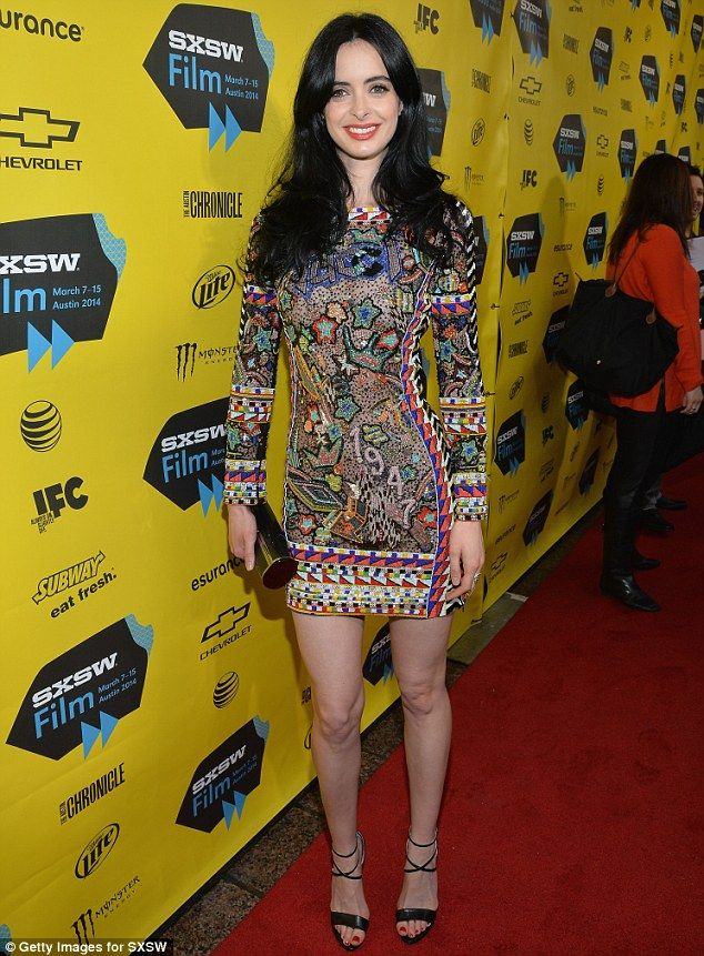 Leggy lady: Ritter, 32, rocked a long-sleeved mini dress featuring elaborate beaded shapes, patterns, and designs - showing off her long ton...