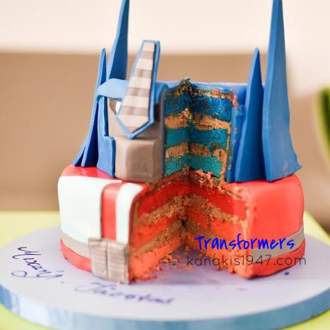 The Transformers Bday-Cake of 4 dimensions !!  Surprise everyone !!  Inside: Light genoise flavored with orange and colored in blue + red tones. The cream is made of milk chocolate Biskelia of Valrhona !!  http://www.kanakis1947.com/#!premium-bithday-cakes/ci50