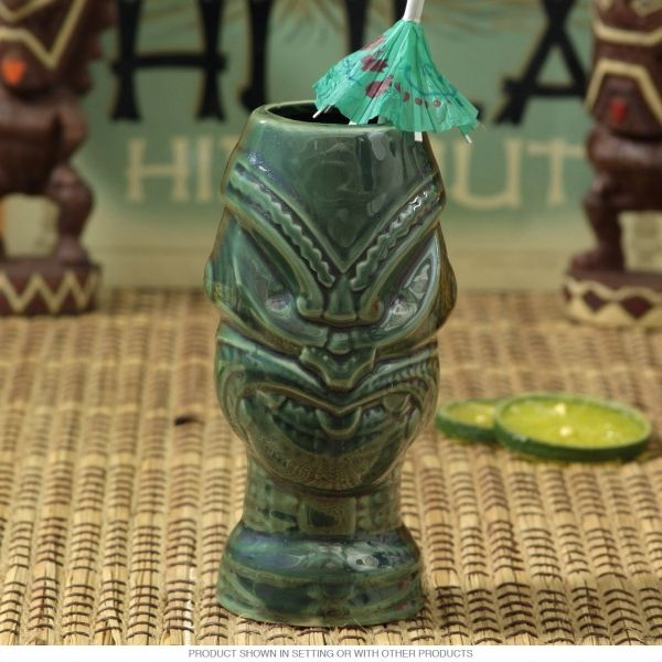 A classic ceramic tiki mug with retro 50s Hawaiian style. This restaurant quality mug sports a hand painted glazed finish and is dishwasher safe. With its vintage tiki cup look and fun bar theme, it fits right in with your tiki bar decor. The perfect Hawaiian party for your favorite tropical drinks. Measures 4