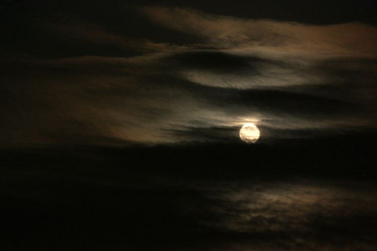 Tonight's Full Sturgeon Moon emerging for a few moments from the clouds.