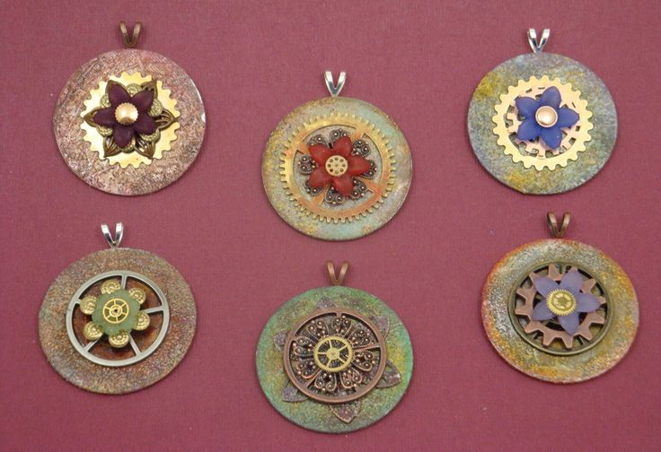 Washer pendants -- pinned for the image, not a tutorial. The metal looks like some sort of chemical action was performed. Not sure how the clasp was attached.