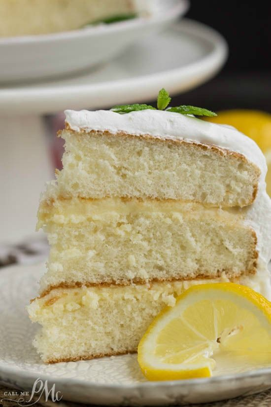 a tender white cake filled with tart lemon curd and covered with a fluffy whipped cream frosting - Lemon Cake