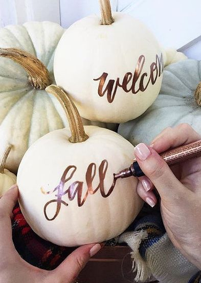 Use a sharpie to decorate pumpkins for fall!