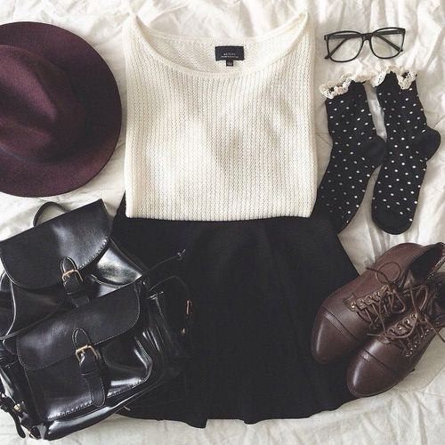 Black skater skirt+black leather ruck sack+dark brown booties+plum hat+black and white frilly socks+black glasses+white tank//