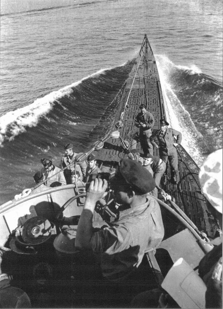 U-Boats ~ German U-Boot U-100 on final approach to the German base at Lorient, France in Sept 1940. U-U-U-Boats ~ While nobody looks too concerned about a visit from the British, note that the lookout is keeping a sharp eye to the north - and England.~ BFD