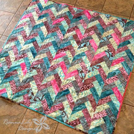 Learn to make a Batik Braid quilt using pre-cut jelly roll fabric strips. Learn to make spineless feathers in free motion quilting to finish the quilted project.