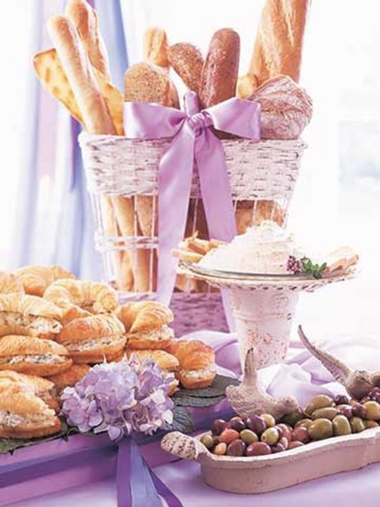 Displays of breads and cheeses and croissant sandwiches with olives and such. Cute!
