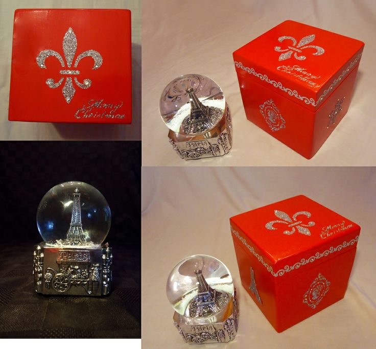 Paris theme musical water globe. This snow globe displays the Eiffel tower & plays a holiday song. It also comes with its own custom made wooden gift-box.   Swarovski rhinestones accents around lid, top and on designs. Fleur de Lis (stylized lily flower) design on top, an important symbol in French Heraldry