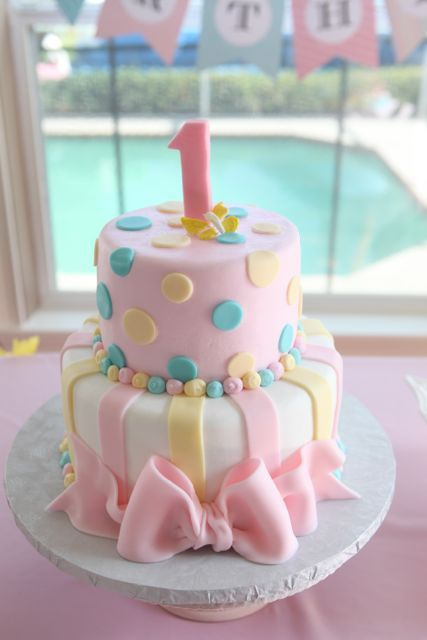 This first birthday cake is pretty in pastel!