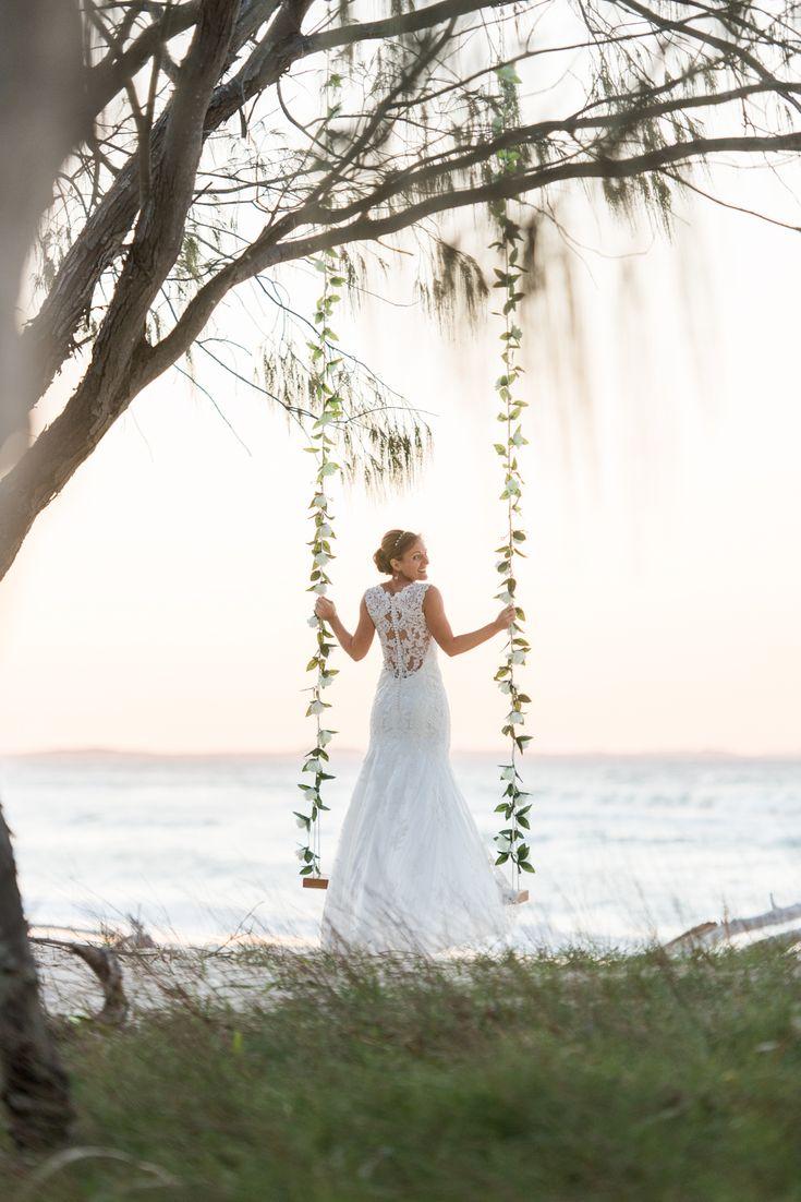 A bride on a swing on the beach... whaaaaat   North Stradbroke Island stradbrokeislandphotography.com