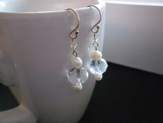 Beautiful sparkling dangling earrings made from 14K gold (goldfilled), freshwater Pearls and clear facettes Crystals. One beautiful item for a wedding or a date. Made by JHFWBeadsAndFindings at Etsy